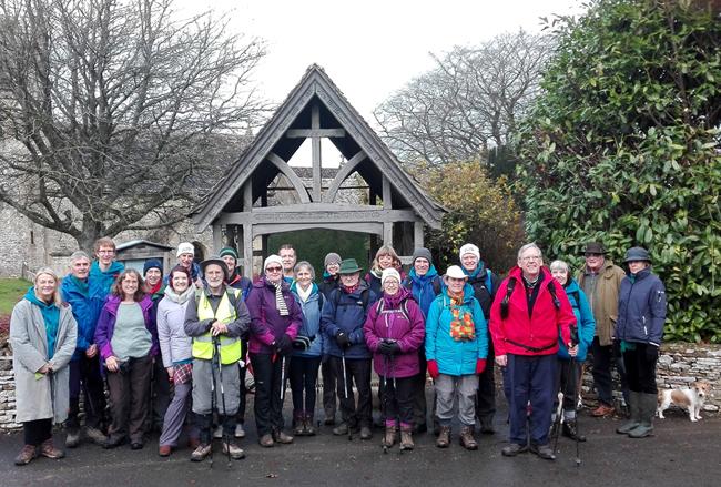 Group photo: pilgrims at a church gate.