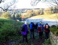 Pilgrims walking on a frosty hill.