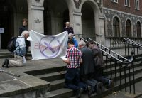 People praying outside Church House.