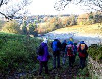 Pilgrims walking on a frosty hill.